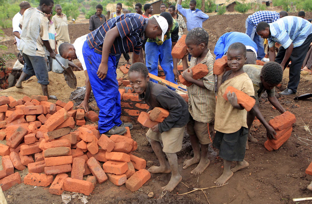 African children carry bricks