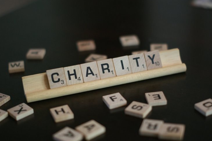 Scrabble pieces spell out the word charity