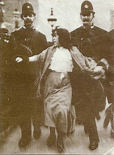 The arrest of teenage suffragette by policemen in 1907.