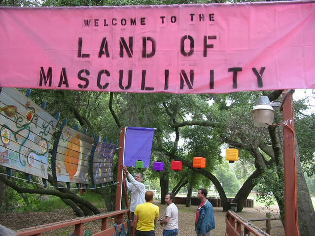 Men gathered under a sign that reads: Welcome to the land of masculinity.
