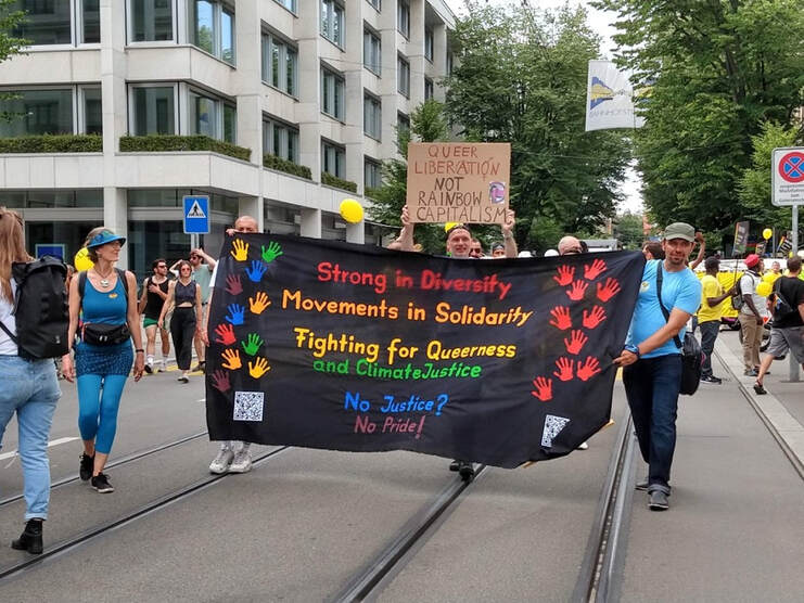 Protesters at Pride march in Zurich 2019. Sign reads